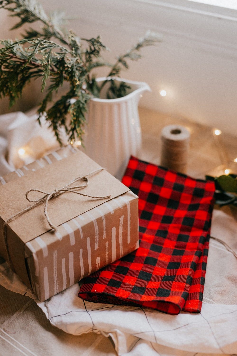 brown and white gift box on red and white checkered textile