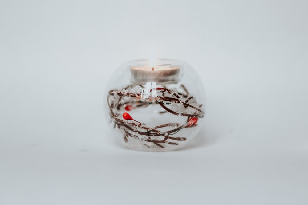 clear glass jar with white light