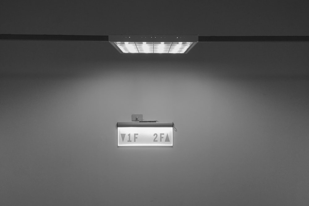 white wall mounted device at 21