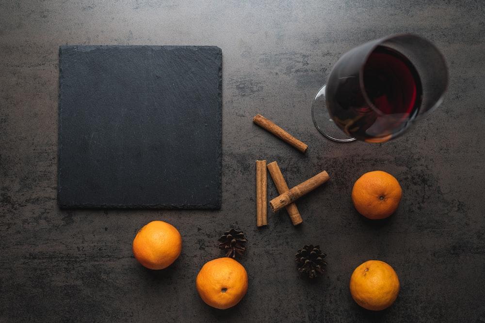 orange fruit beside black board