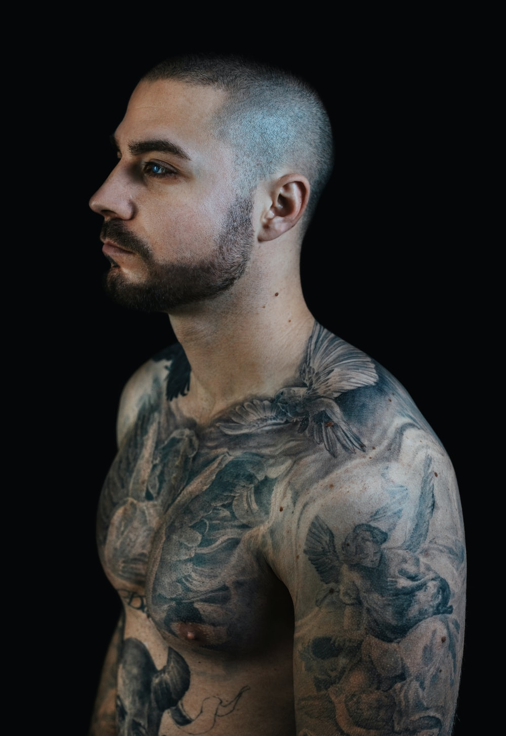 man with blue and black body tattoo
