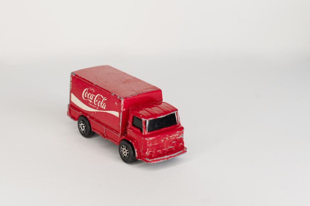 red and white truck toy
