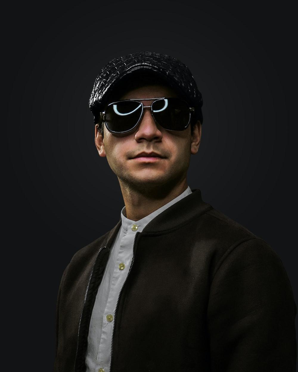man in black suit wearing black sunglasses