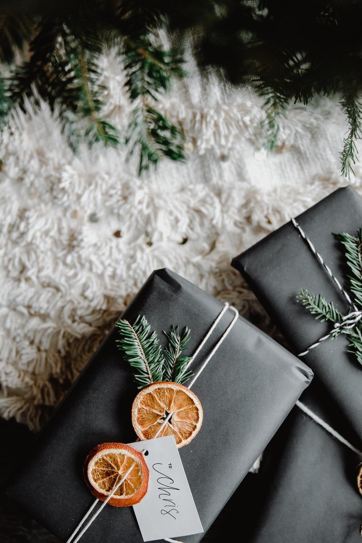 black leather bifold wallet on white textile
