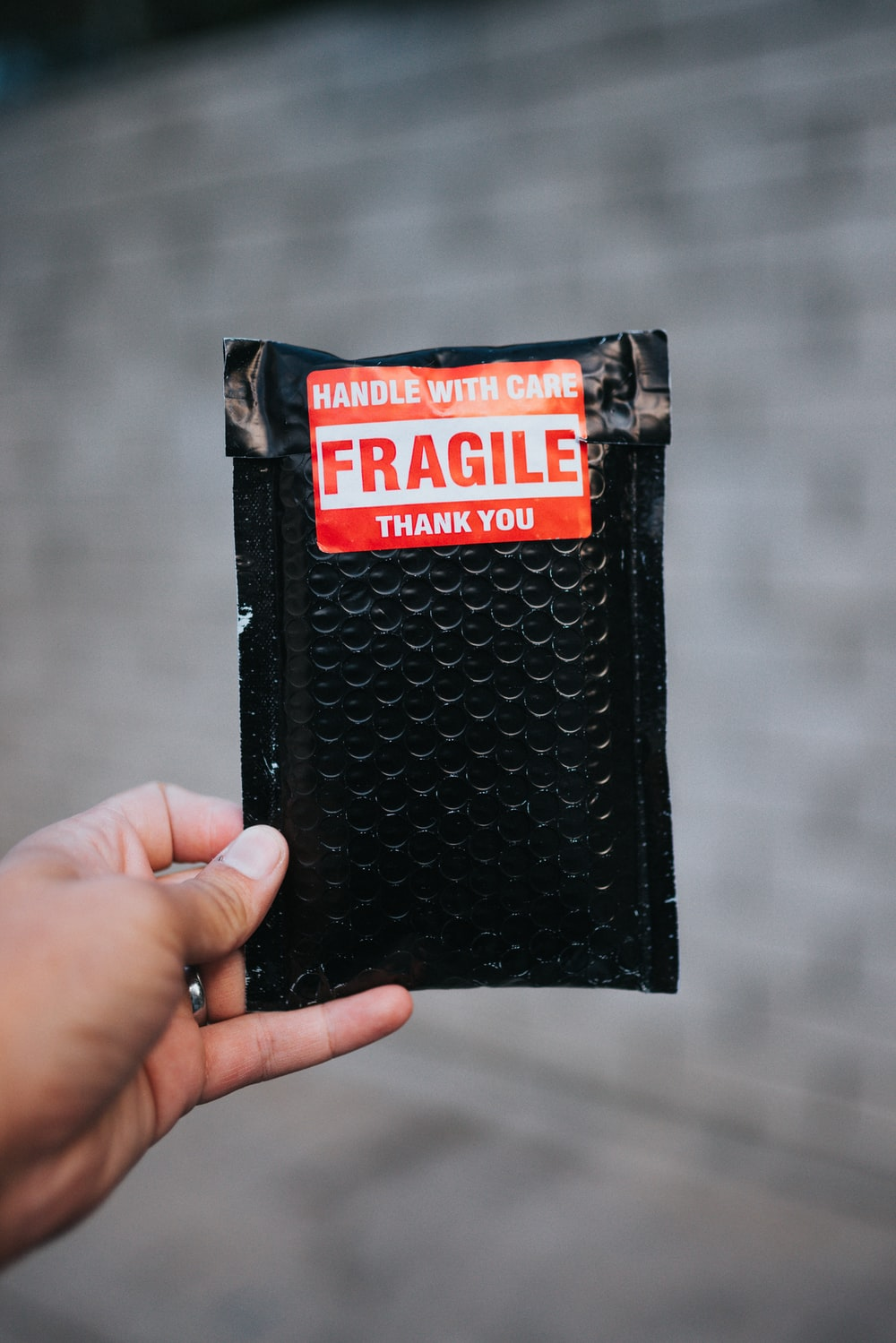 black and red leather bifold wallet