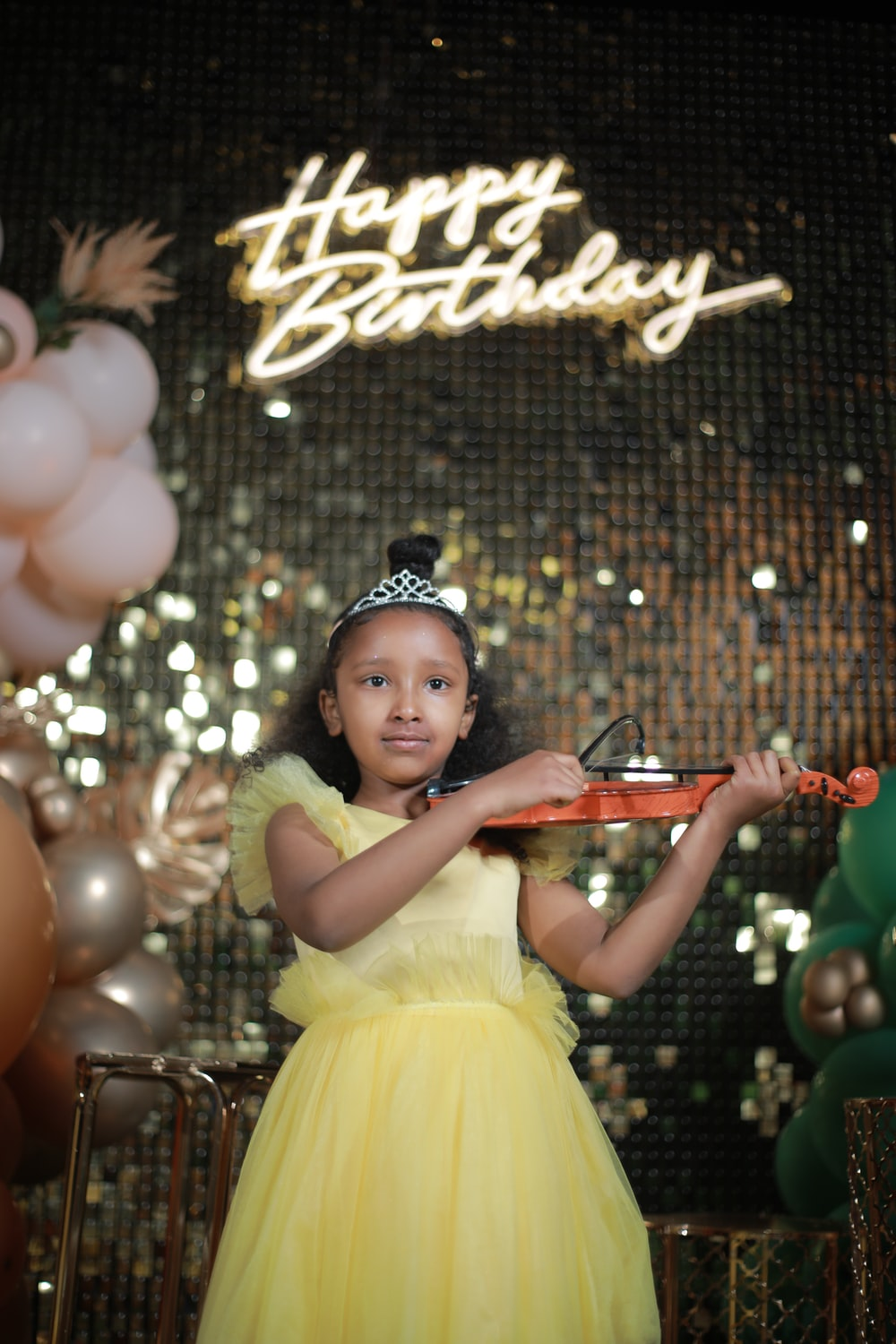 girl in white dress playing violin