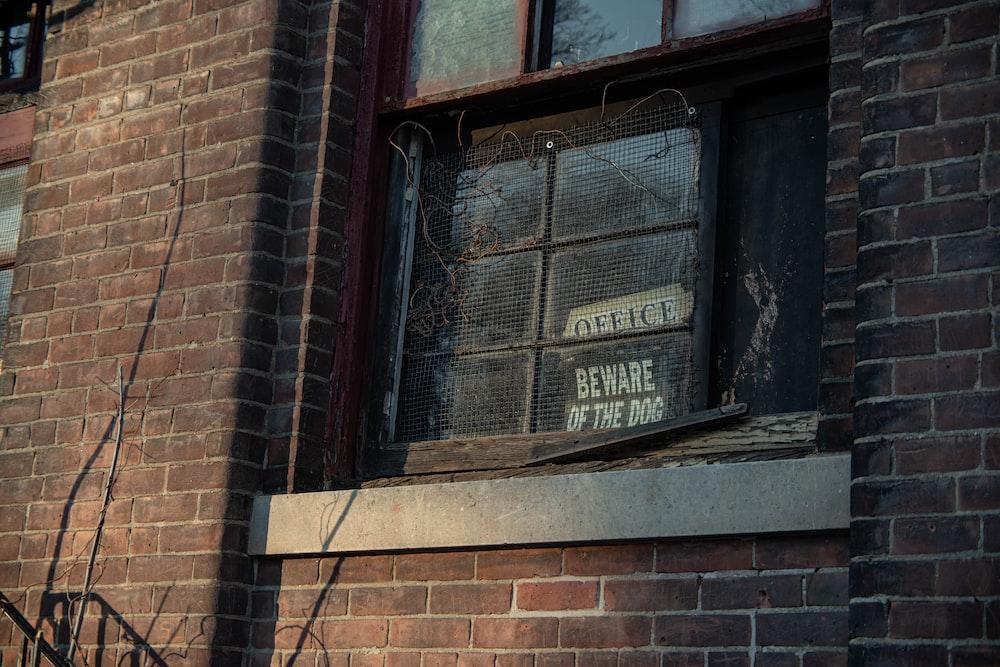 brown brick wall with glass window