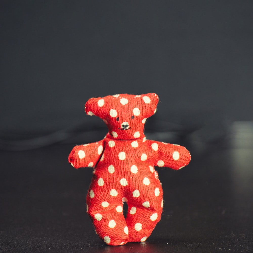 red and white polka dot bear plush toy