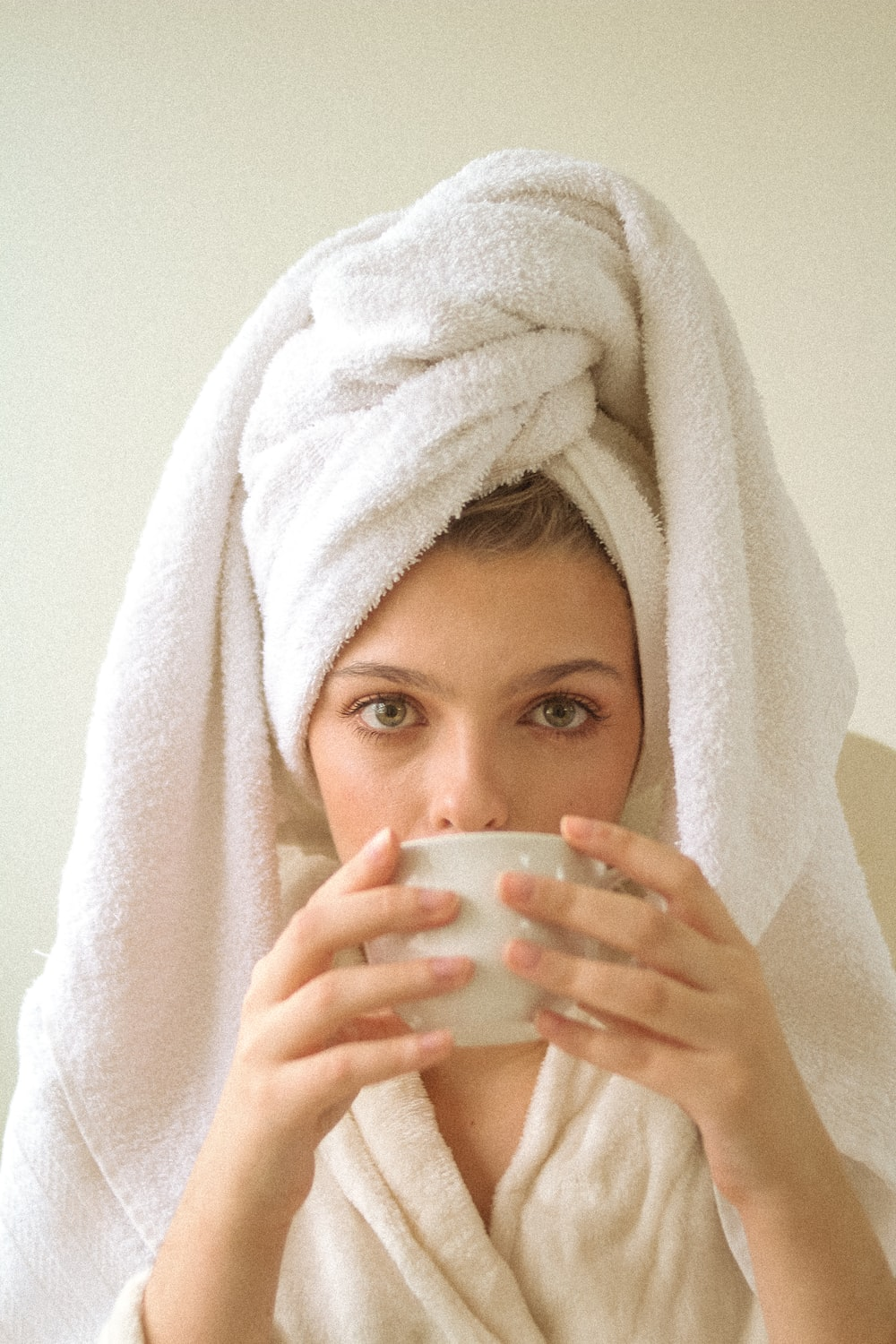 woman covering her body with white towel