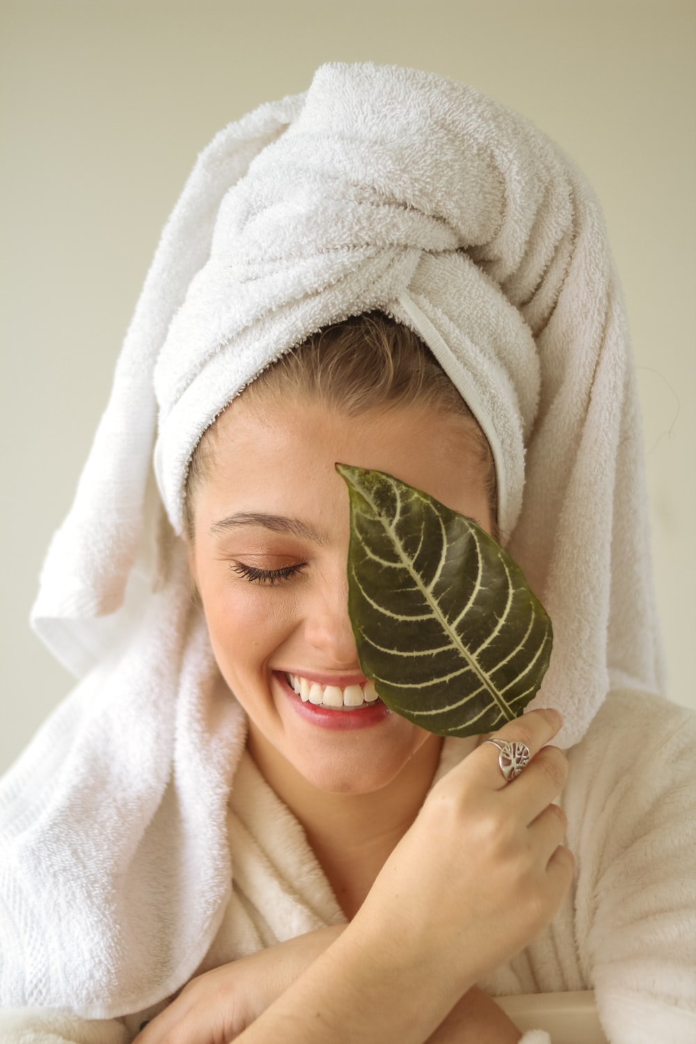 woman covering her face with white towel