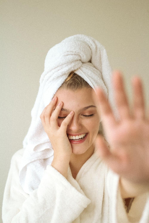 smiling woman in white bathrobe