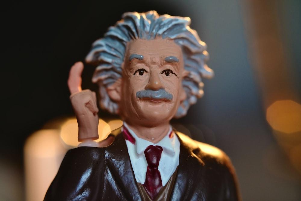 man in black suit jacket figurine