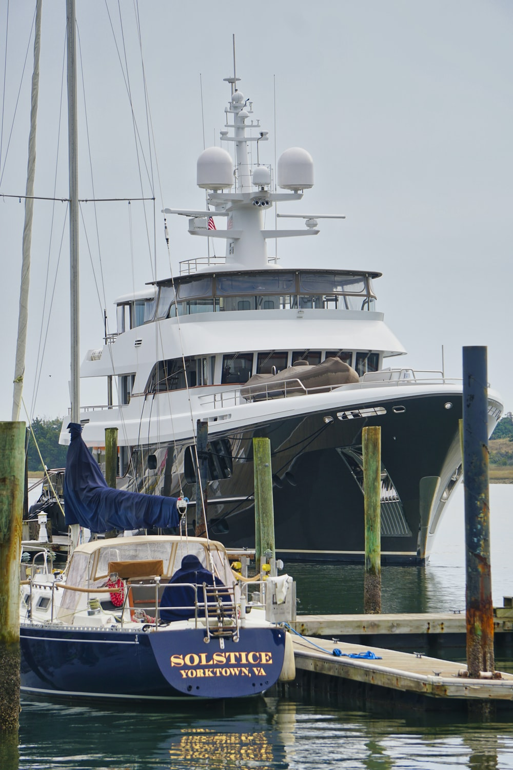 white and blue yacht on dock during daytime