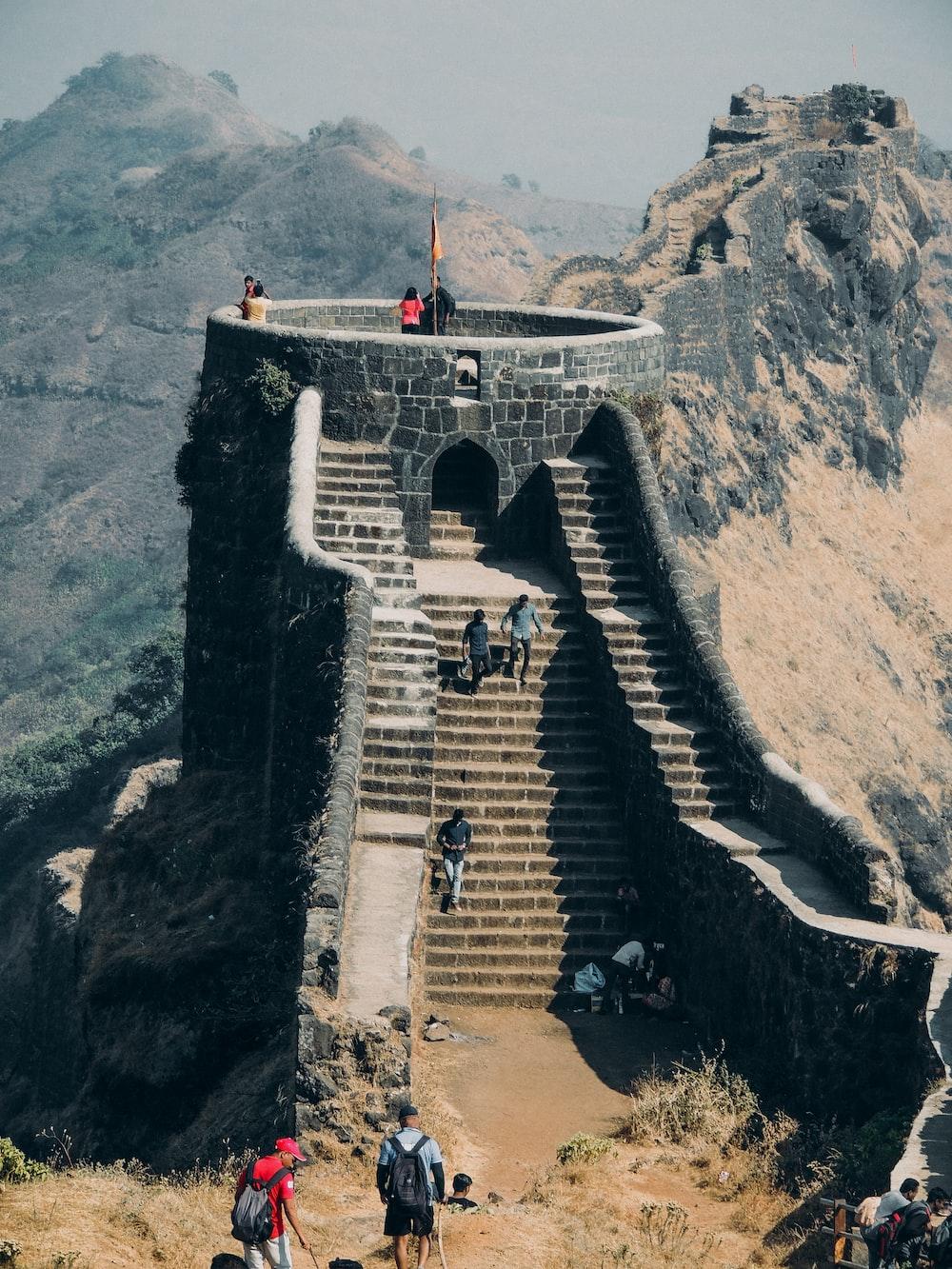 people walking on concrete bridge during daytime