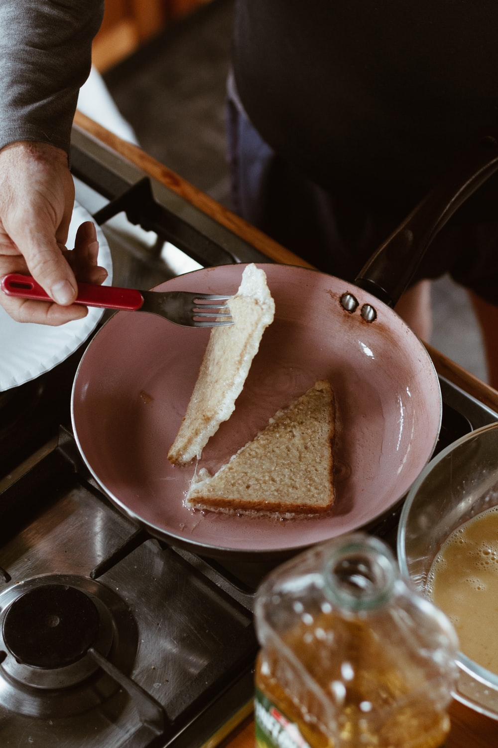 person holding brown bread on blue ceramic plate