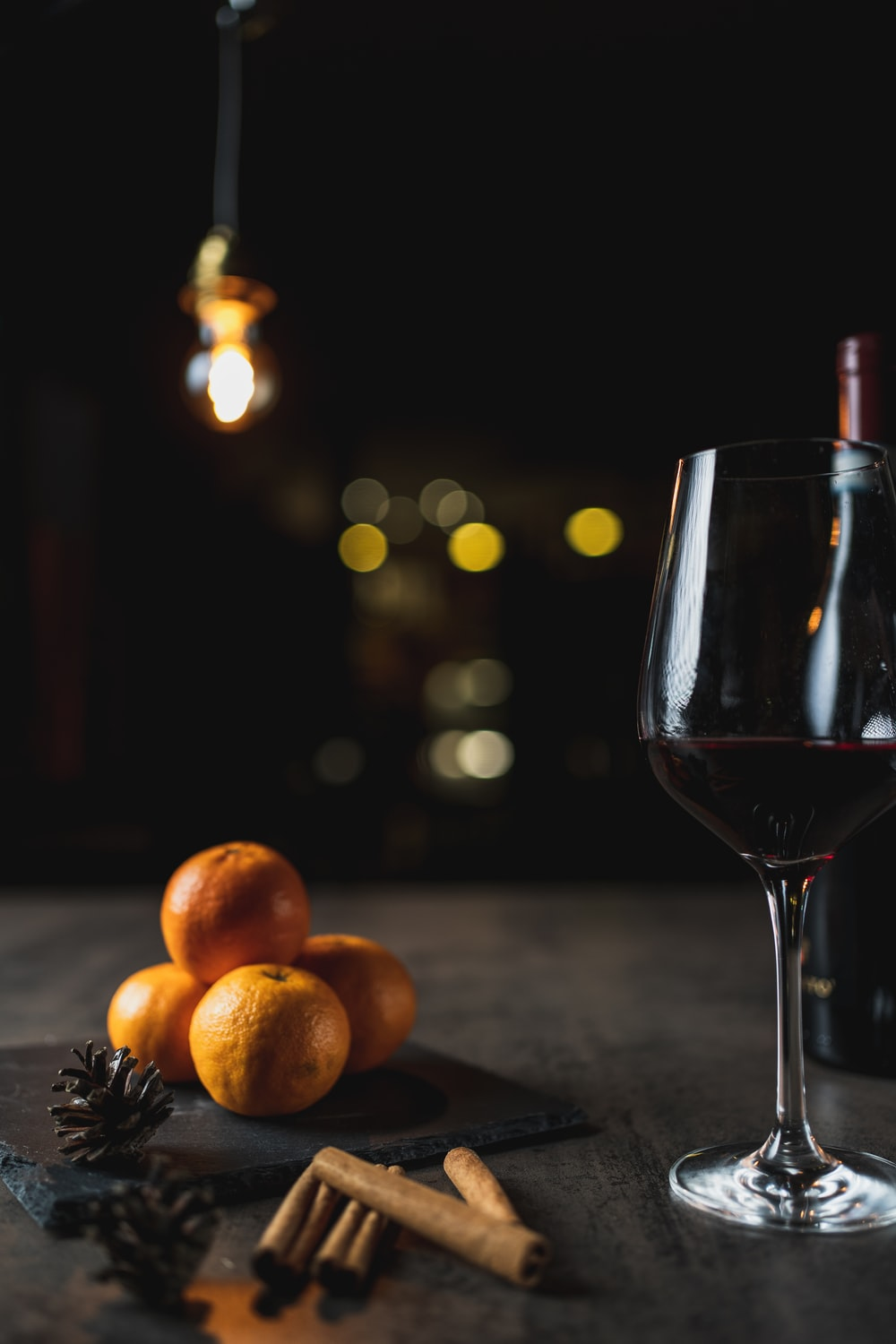 clear wine glass with red wine on brown wooden table