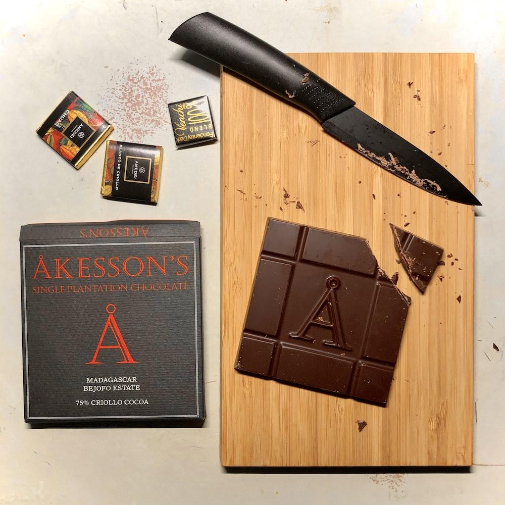 black and silver pocket knife beside black book
