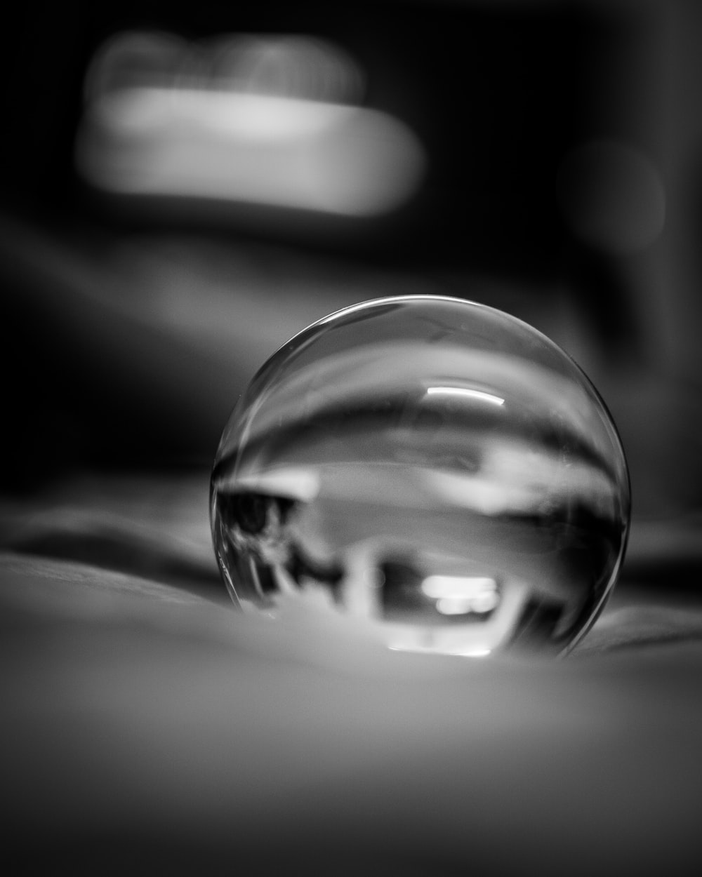 grayscale photo of water drop
