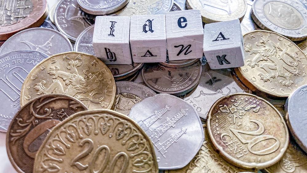 silver round coins on white box