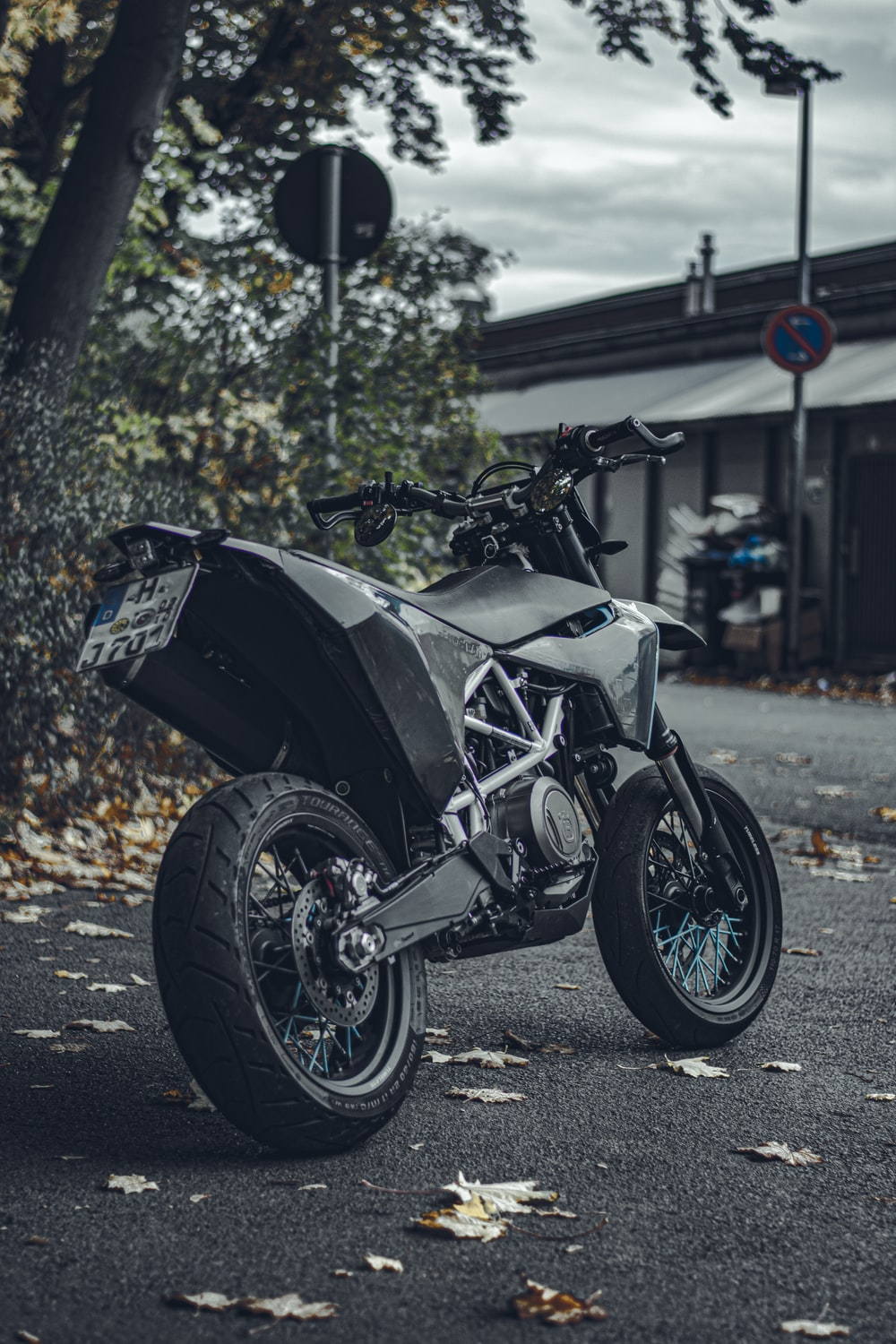 black and silver sports bike parked on the street during daytime