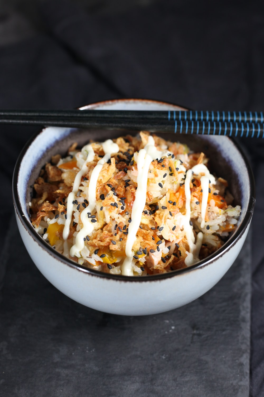 white ceramic bowl with rice and meat dish