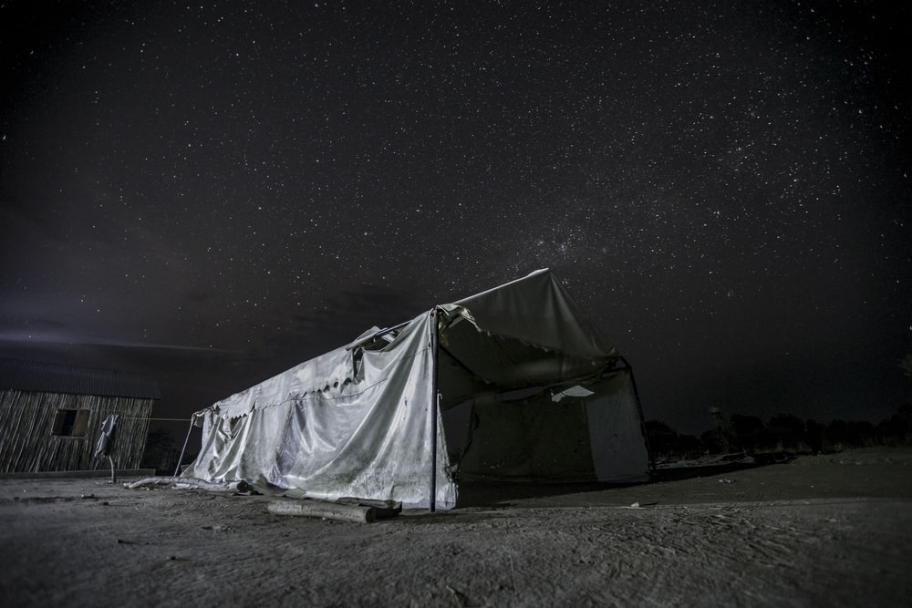 white tent under starry night