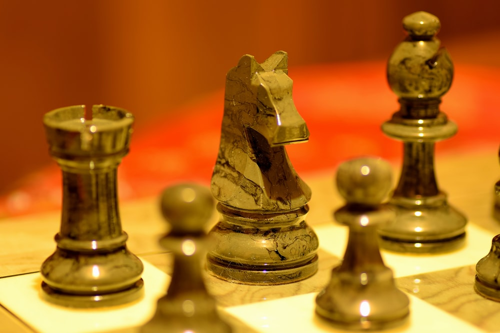 brown and gray chess piece