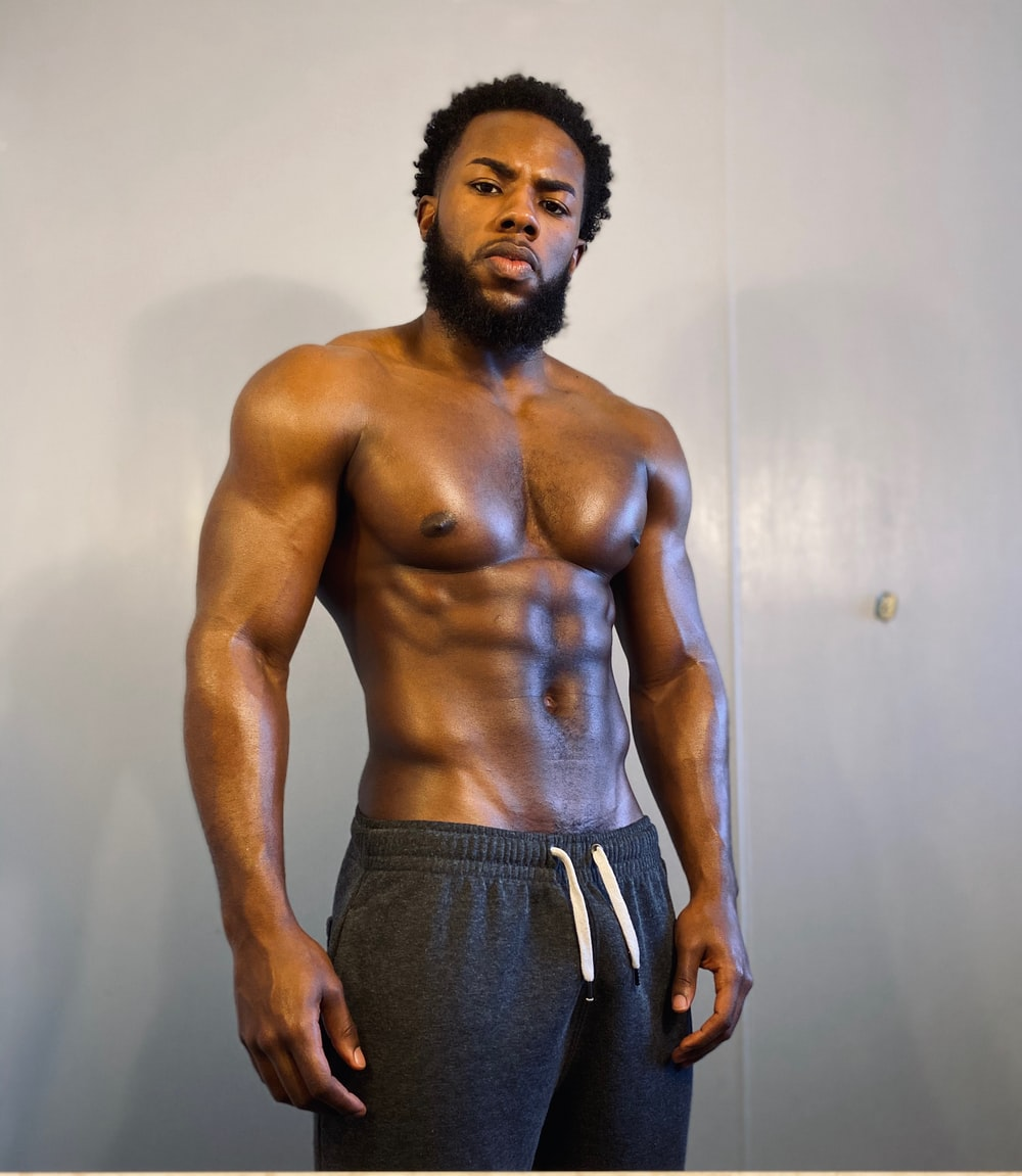 topless man in black pants