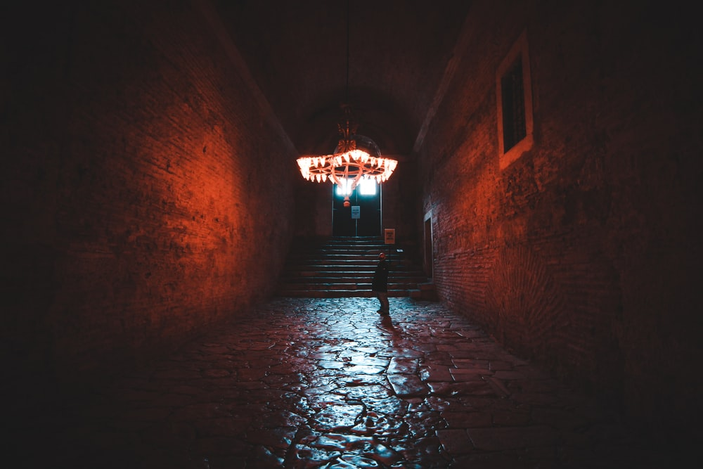 brown brick tunnel with light