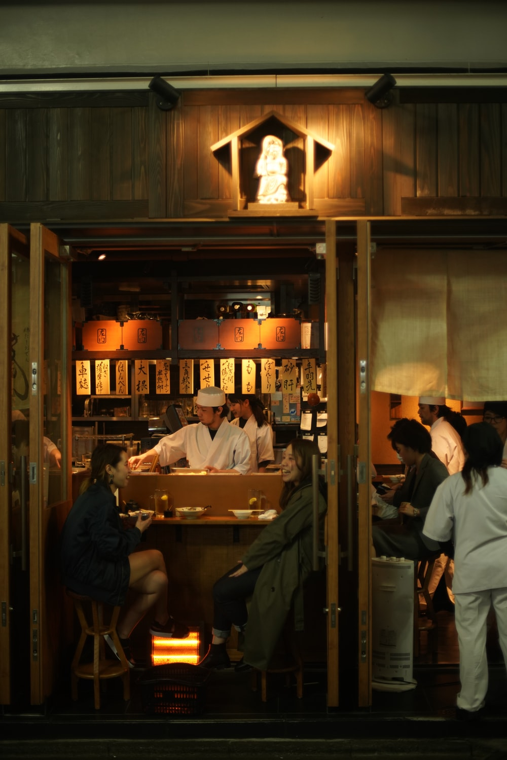 people sitting at the table inside restaurant