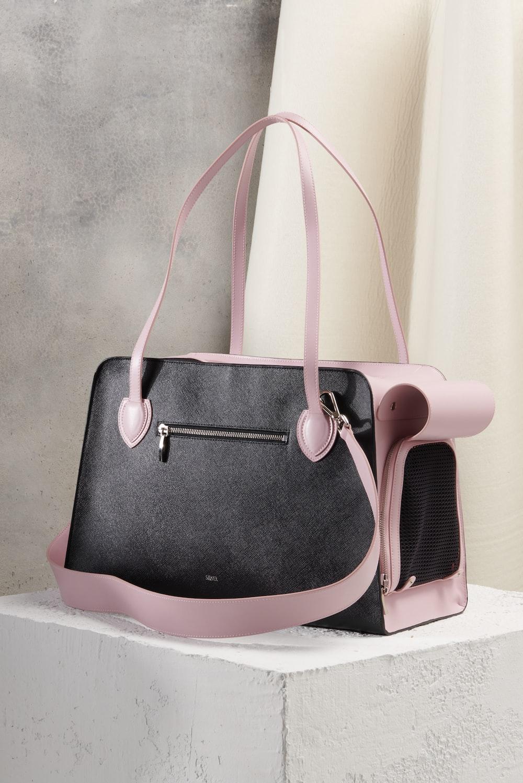 black and pink leather handbag