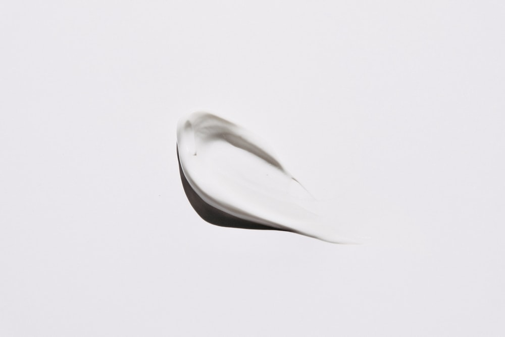 stainless steel spoon on white surface