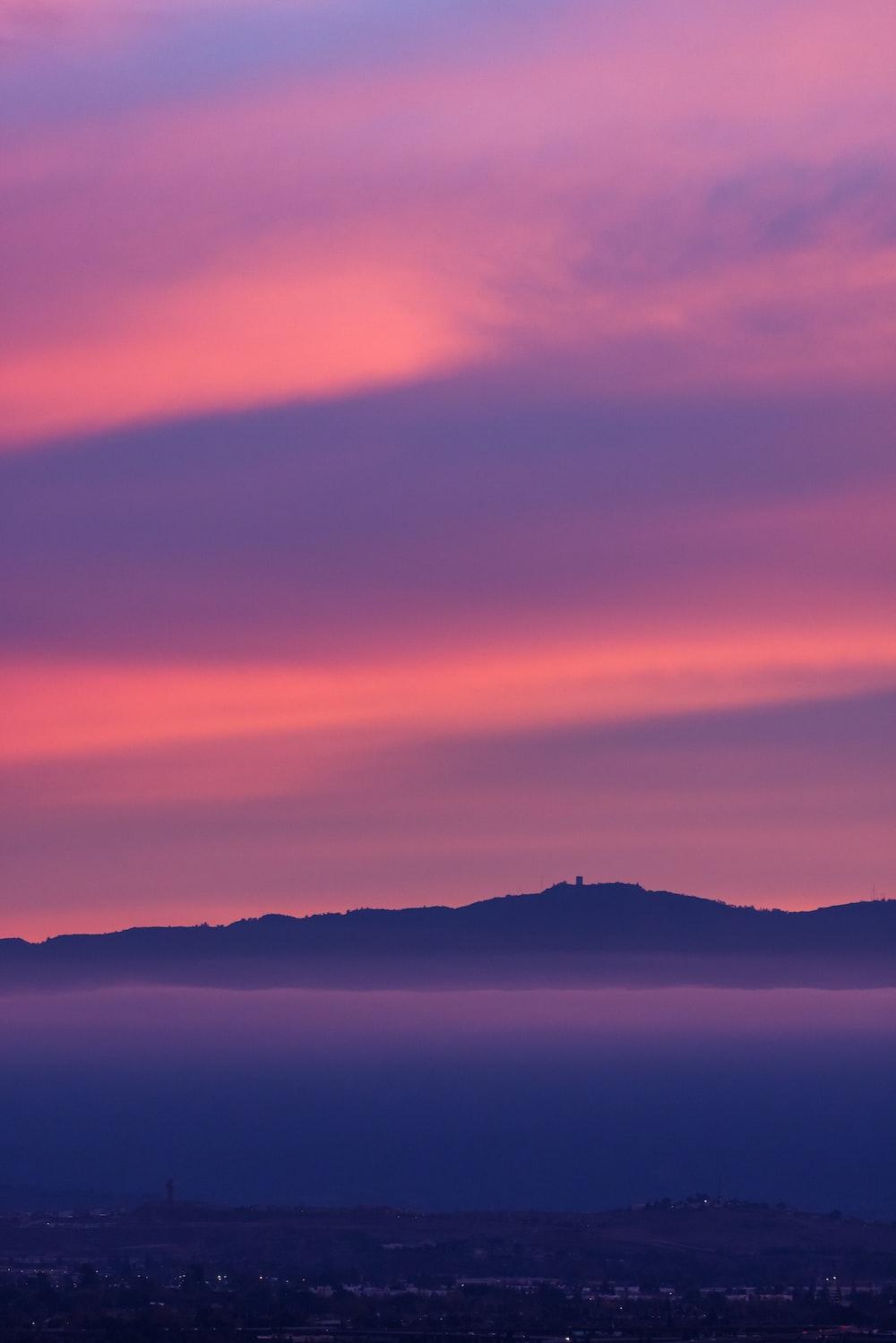silhouette of mountain under purple sky