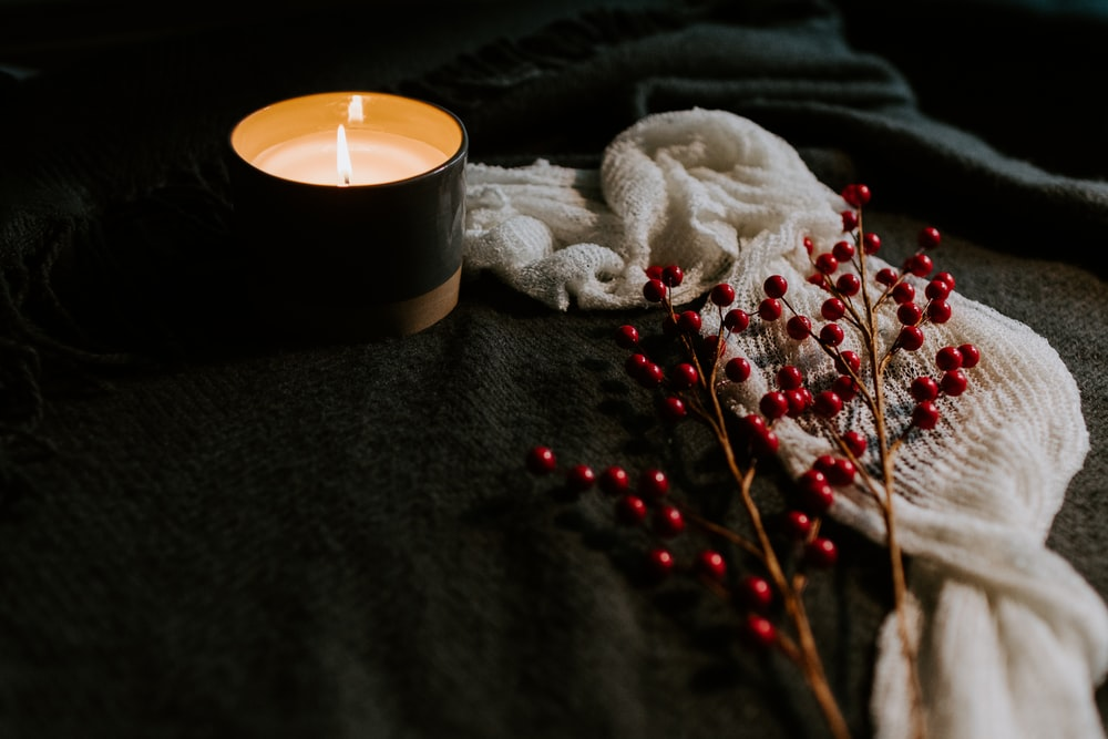 white candle on black holder
