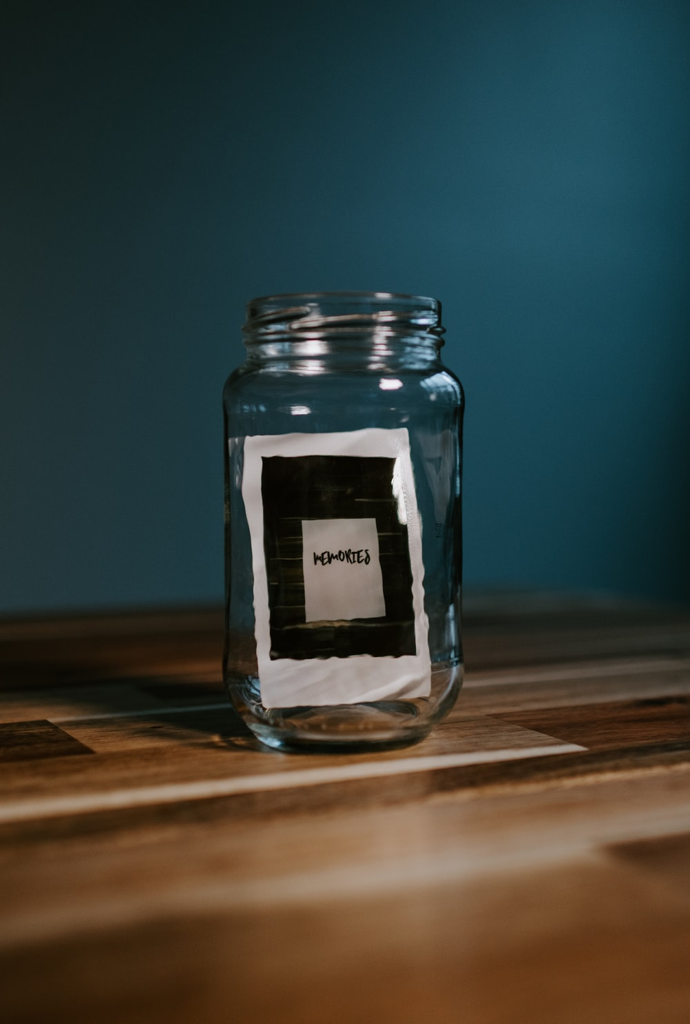 clear glass jar on brown wooden table