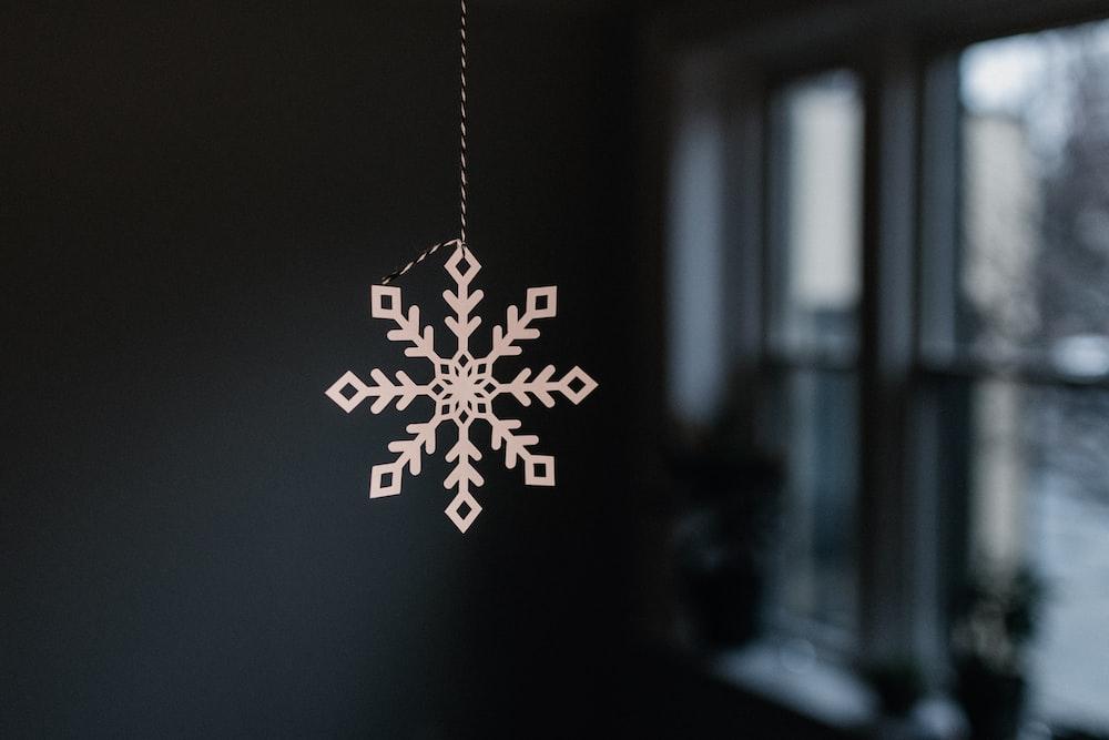 silver and white snowflake pendant