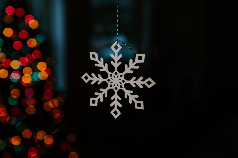 white and black snowflake illustration