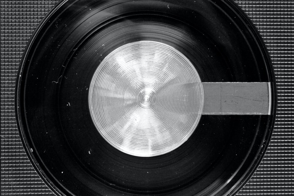 black and silver vinyl record