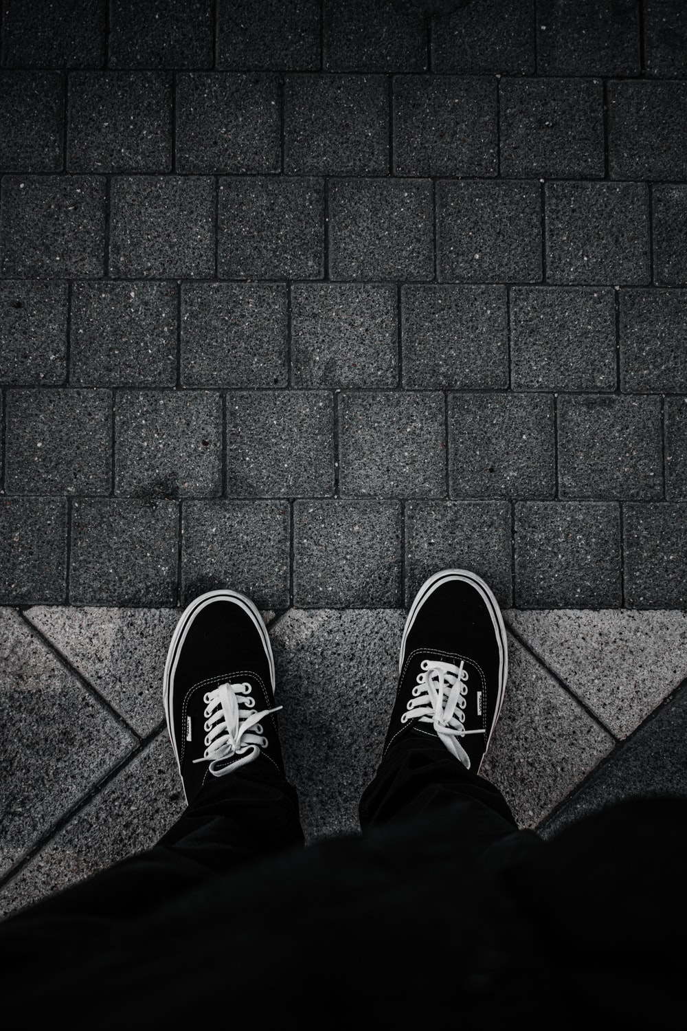 person in black and white sneakers