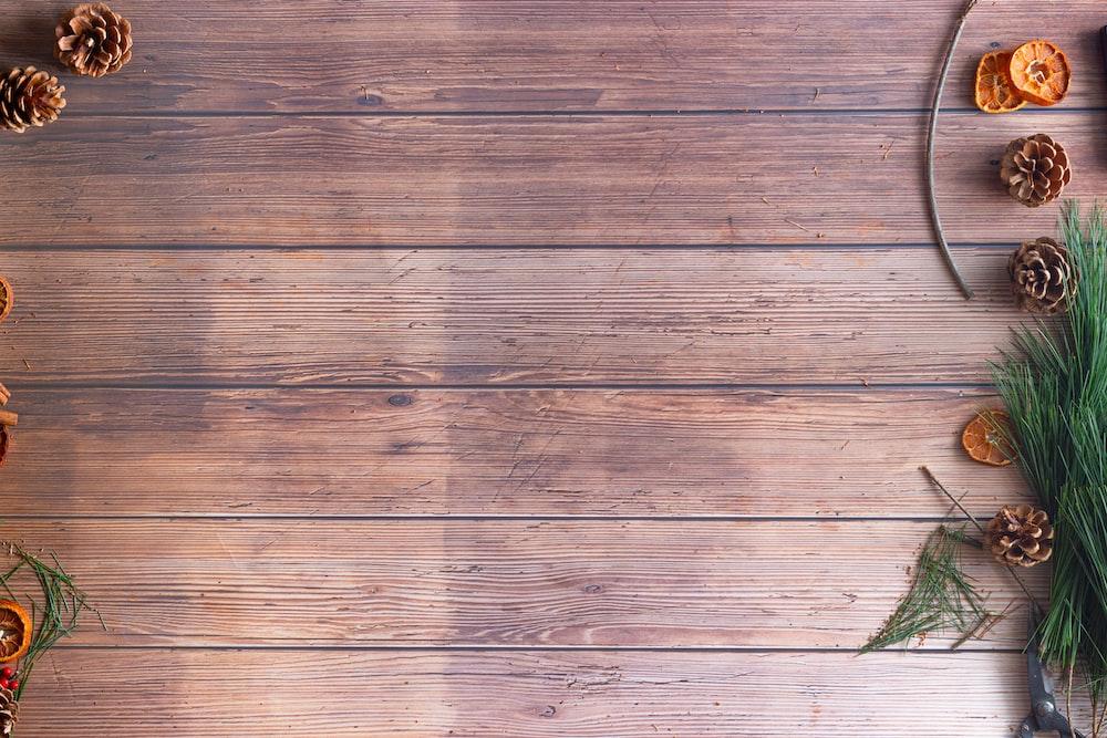 green leaf on brown wooden floor