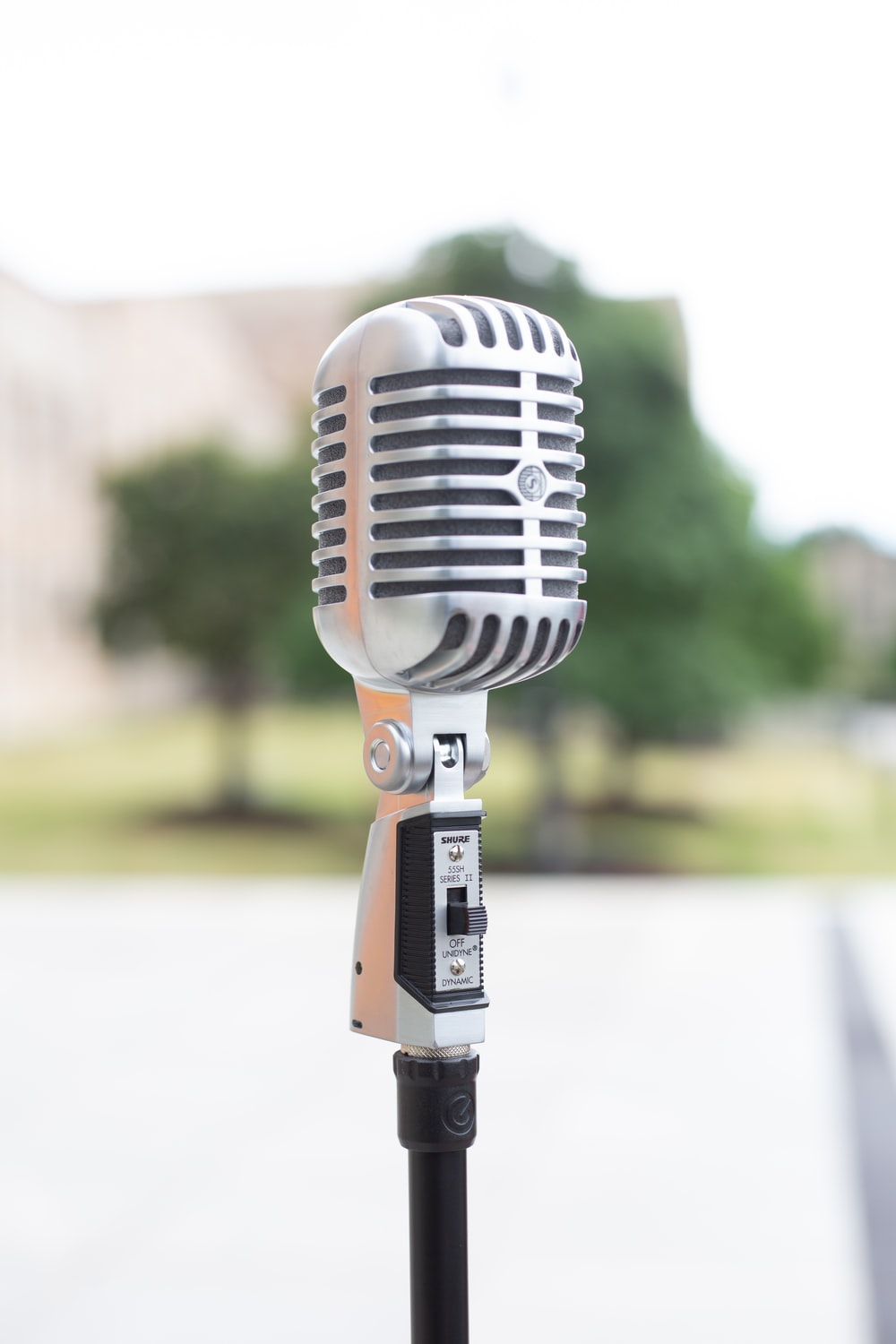 silver microphone on white table