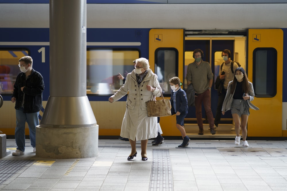 woman in white coat standing on white floor tiles