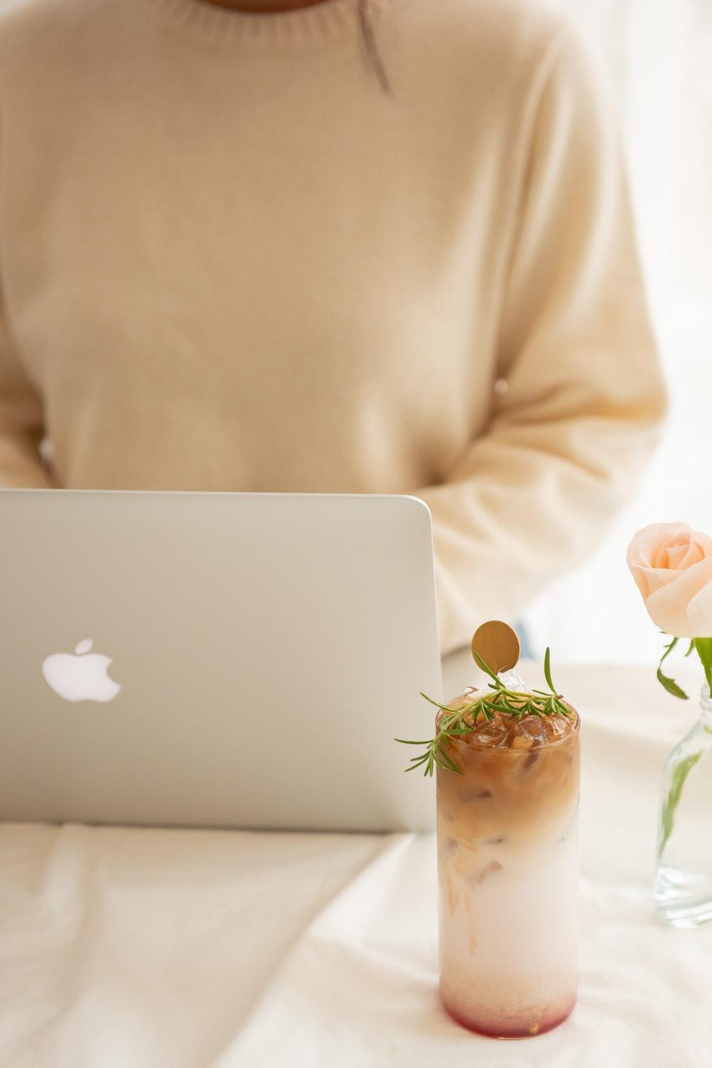white rose on white macbook