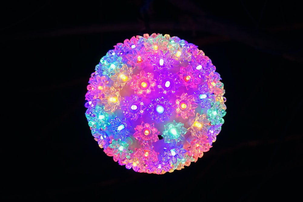 pink green and blue round ornament