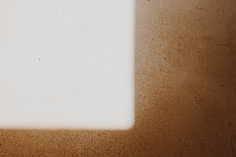 white card on brown surface