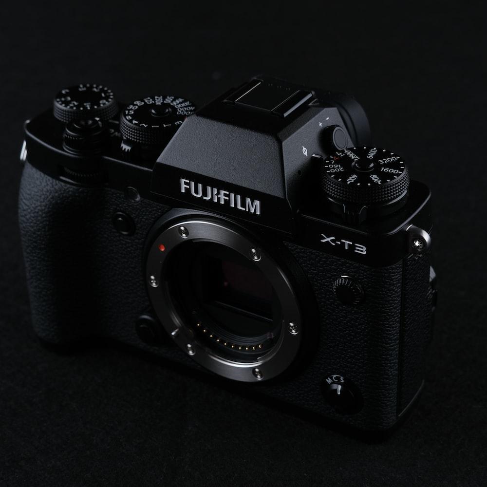 black nikon dslr camera on black surface