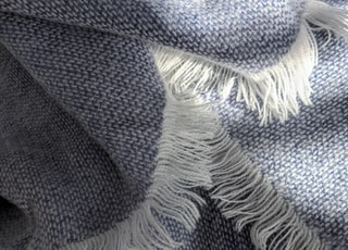 blue and white knit textile