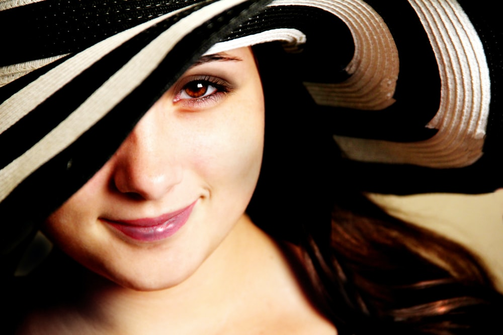 woman wearing black and white hat