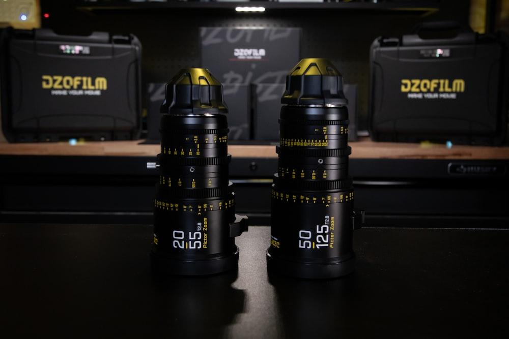 black and yellow nikon dslr camera lens