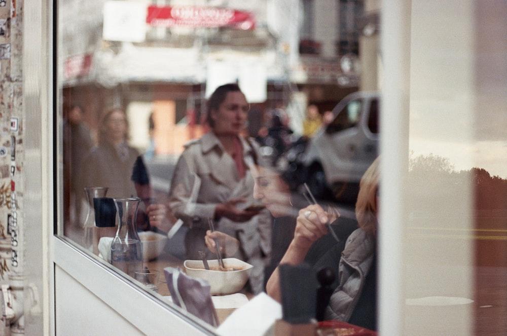 man in gray dress shirt sitting beside woman in black jacket